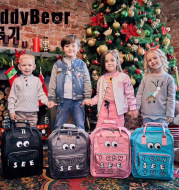 Cup with bear children's school bag primary school big eyes cute pattern backpack boys and girls creative backpack
