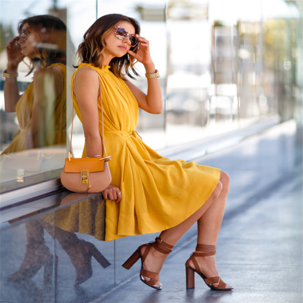 woman sitting in yellow dress, forever21