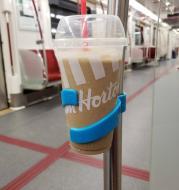 Portable public transportation cup holder