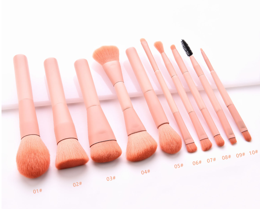 different types and sizes of pink makeup brushes